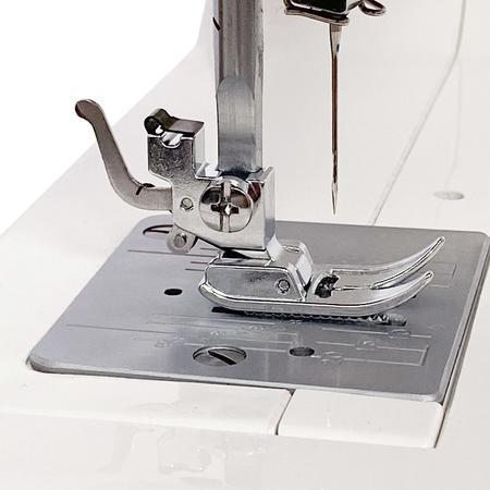 Uchwyt Matic szybkomocujący stopki do maszyn z chwytaczem wahadłowym, fig. 1